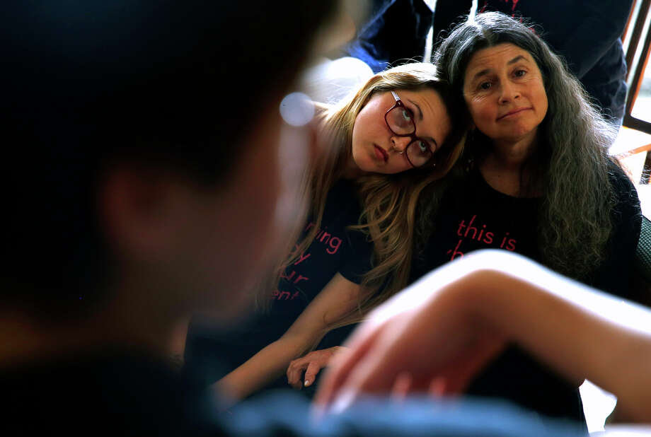Maya Siskin-Lavine, 16, and her mother, Sharon Siskin, listen to a speaker at the Stop Harassing meeting on Sunday. About 60 to 70 Berkeley High students take part in the group. Photo: Scott Strazzante / The Chronicle / ONLINE_YES