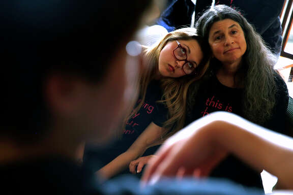 Maya Siskin-Lavine, 16, and her mother, Sharon Siskin, listen to a speaker at the Stop Harassing meeting on Sunday. About 60 to 70 Berkeley High students take part in the group.