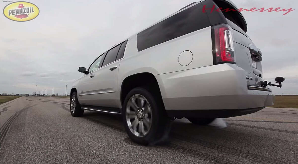 Houston's motorheaded madman John Hennessey puts a souped up version of a GMC Denali to the test: first seeing it top 110 miles per hour on a quarter-mile, then racing it against a Dodge Charger Hellcat. The results are astonishing. Source: Hennessey Performance on YouTube