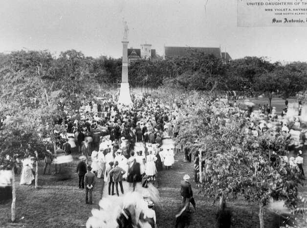 Pictured, the dedication of the Confederate monument at Travis Park drew a crowd in 1900. Named for the commander at the Alamo, Travis Park has been a San Antonio landmark since the 1870s. Photo: Saen File Photo /