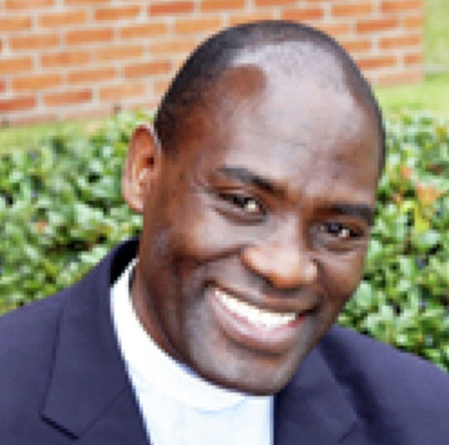 Israel Ahimbisibwe, 51, the vicar at Redeemer Episcopal Church, was found dead along with his wife, Dorcas, and their 5-year-old son, Israel Jr. Photo: Episcopal Diocese Of Texas / Episcopal Diocese of Texas