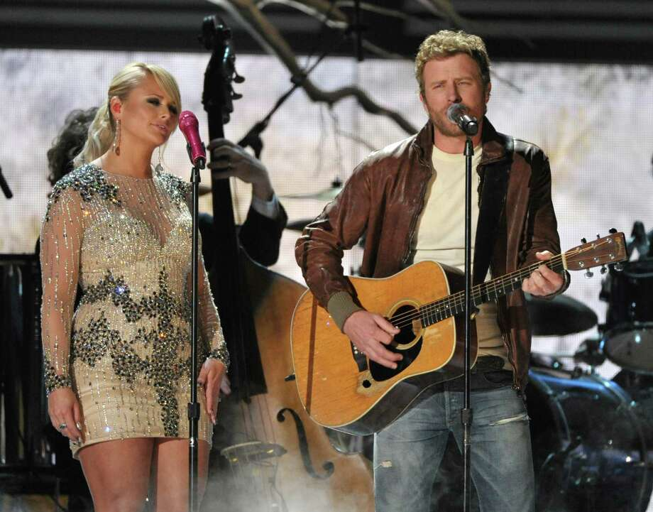 FILE - In this Feb. 10, 2013 file photo, Miranda Lambert, left, and Dierks Bentley perform at the 55th annual Grammy Awards in Los Angeles. Bentley says there won't be any hard feelings if childhood friend Miranda Lambert takes home the Grammy for best country album. Lambert is already a Grammy owner, but Bentley is still waiting for his first win. The 57th annual Grammy Awards will air live from the Staples Center in Los Angeles. (Photo by John Shearer/Invision/AP, File) ORG XMIT: NYET102 Photo: John Shearer / Invision