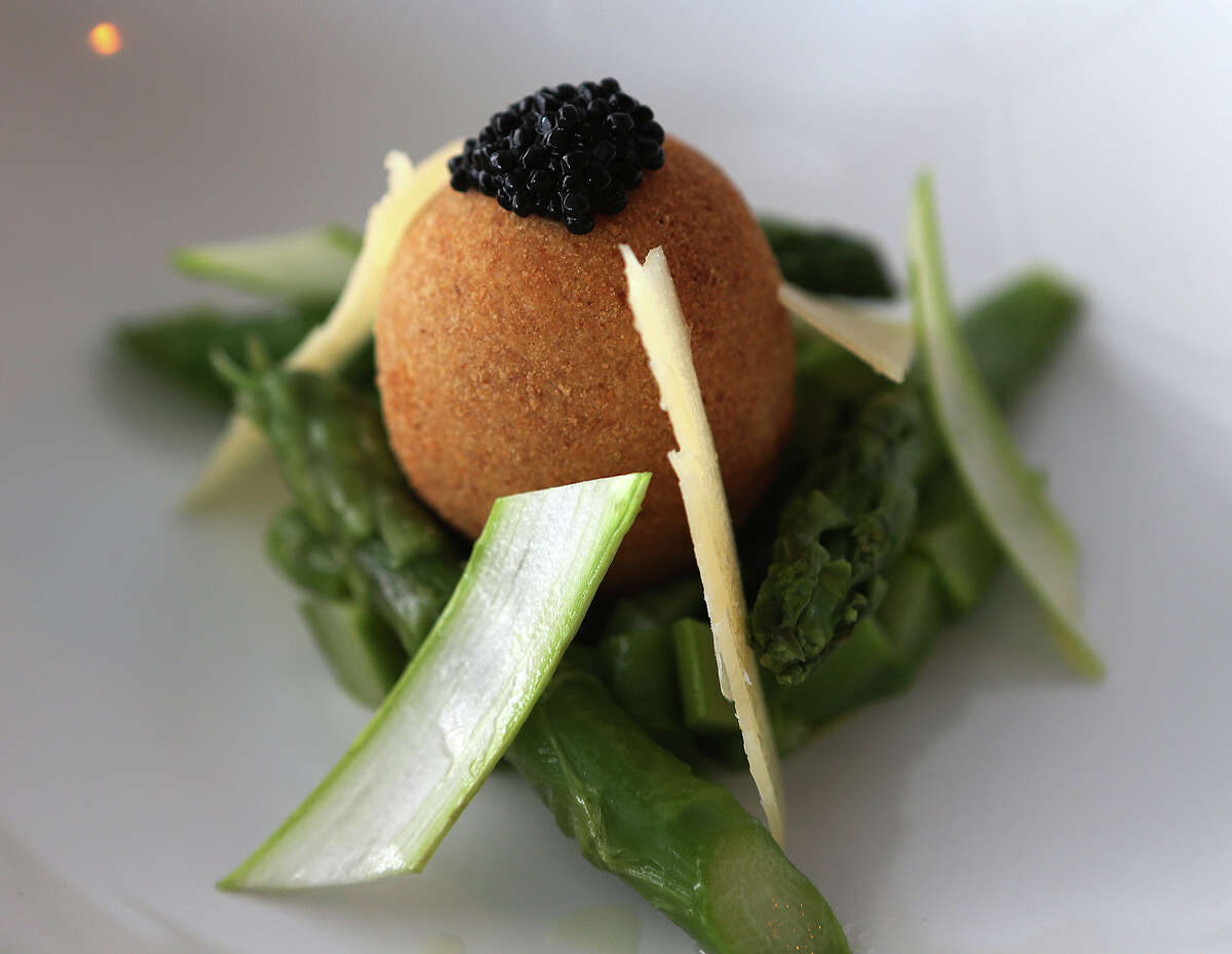 The soft boil breaded egg at Saveurs 209 comes with seasonal vegetables.