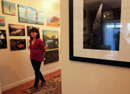 """Artist Judi Gorski with her showcased artwork before the opening of BigCrow Exhibition Space's show """"Big Water."""""""