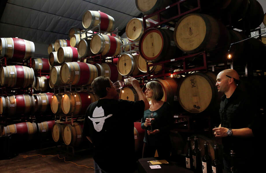 Debbie Stack (left) and Becky White taste wine with owner Isy Borjón at Borjón Winery. Photo: Leah Millis / The Chronicle / ONLINE_YES