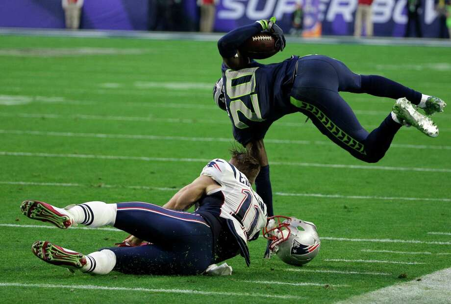New England Patriots wide receiver Julian Edelman (11) tackles Seattle Seahawks cornerback Jeremy Lane (20) after an interception during the first half of NFL Super Bowl XLIX football game Sunday, Feb. 1, 2015, in Glendale, Ariz. (AP Photo/David J. Phillip)  ORG XMIT: NFL211 Photo: David J. Phillip / AP