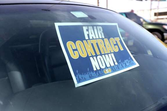 A sign in a union member's car shows the United Steelworkers' position in its negotiations.