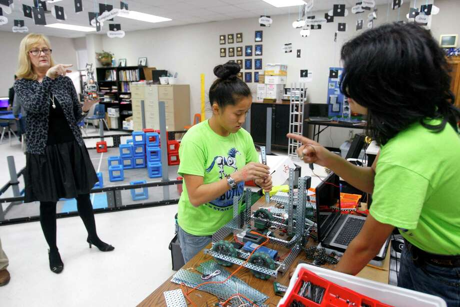 Natalia High School robotics program instructor Candace De Jesus (left) talks Thursday, Jan. 29, 2015, about the three teams she had qualify for the TCEA state robotics competition this year, making the seventh straight year a team from Natalia has qualified for state. Photo: William Luther, San Antonio Express-News / © 2015 San Antonio Express-News