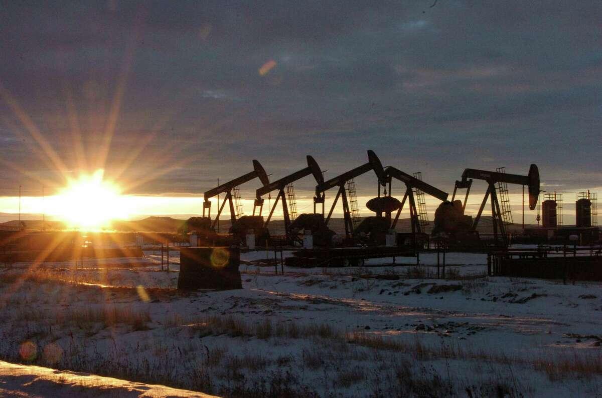 Pump jacks bring oil up from wells in North Dakota. (AP Photo/Matthew Brown)