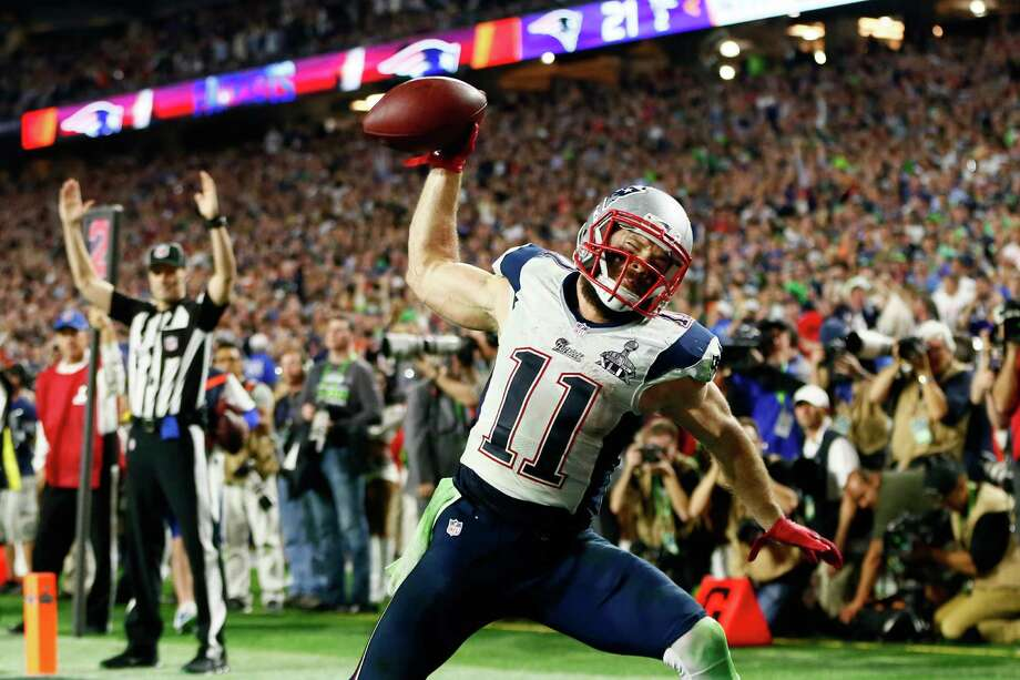 Julian Edelman put himself in position to score the winning touchdown Sunday by passing a concussion test after receiving a hard hit in the fourth quarter. Photo: Kevin C. Cox, Staff / 2015 Getty Images