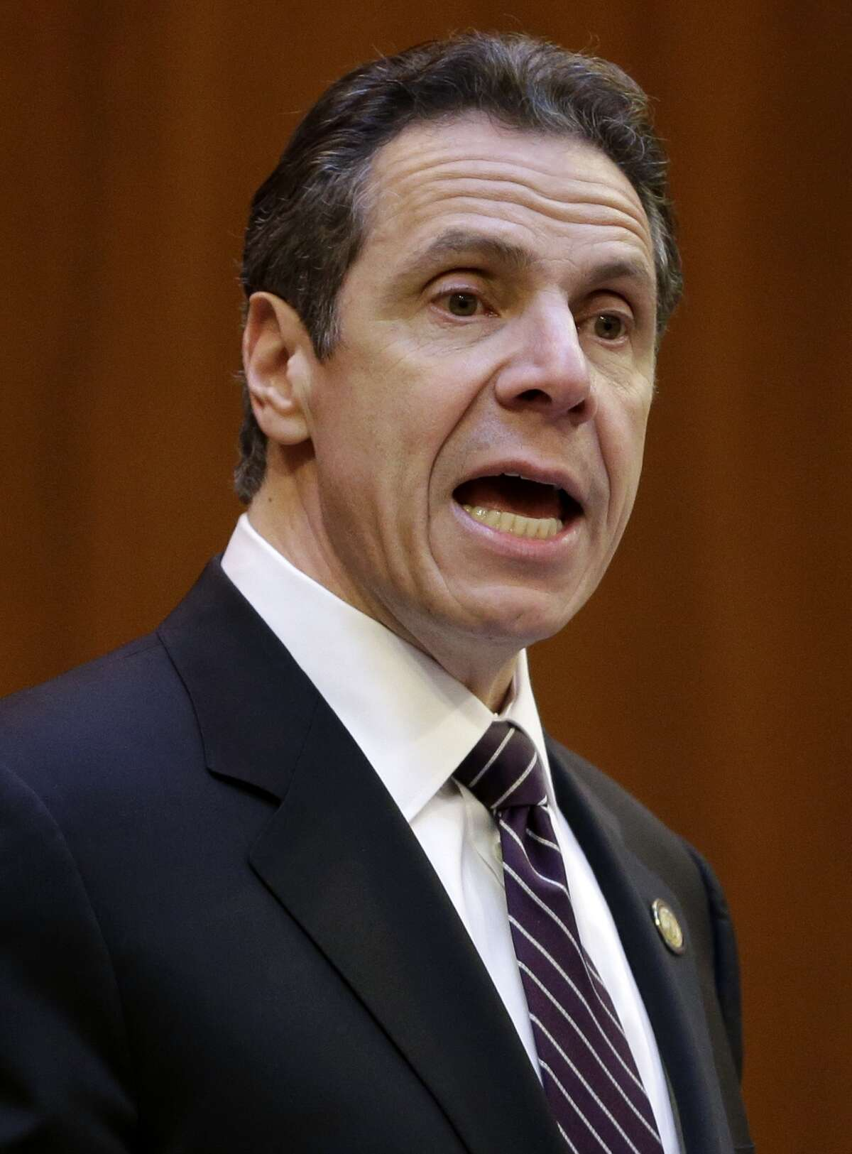 New York Governor Andrew Cuomo speaks at New York University in New York, Monday, Feb. 2, 2015. Cuomo said he won't sign a budget for the state this year that doesn't include an ethics plan for legislators. (AP Photo/Seth Wenig) ORG XMIT: NYSW112