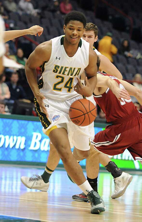 Siena's Lavon Long drives to the basket during a basketball game against Rider at the Times Union Center Monday, Feb. 2, 2015 in Albany, N.Y.  (Lori Van Buren / Times Union) Photo: Lori Van Buren / 00030380A