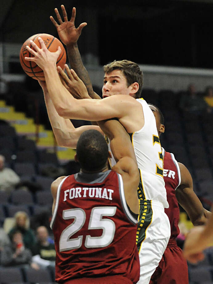 Siena's Rob Poole is fouled as he drives to the basket during a basketball game against Rider at the Times Union Center Monday, Feb. 2, 2015 in Albany, N.Y.  (Lori Van Buren / Times Union) Photo: Lori Van Buren / 00030380A