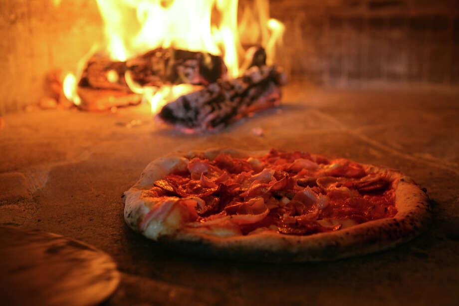 Pork Love pizza from Dough Pizzeria Napoletana Photo: Express-News File Photo / Courtesy photo