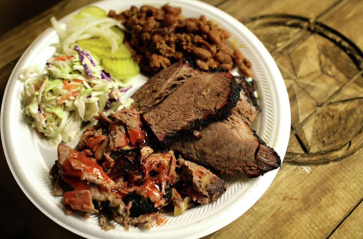 Brisket and Pulled Pork Combo Plate with cole slaw and chili beans from Big Bib BBQ.