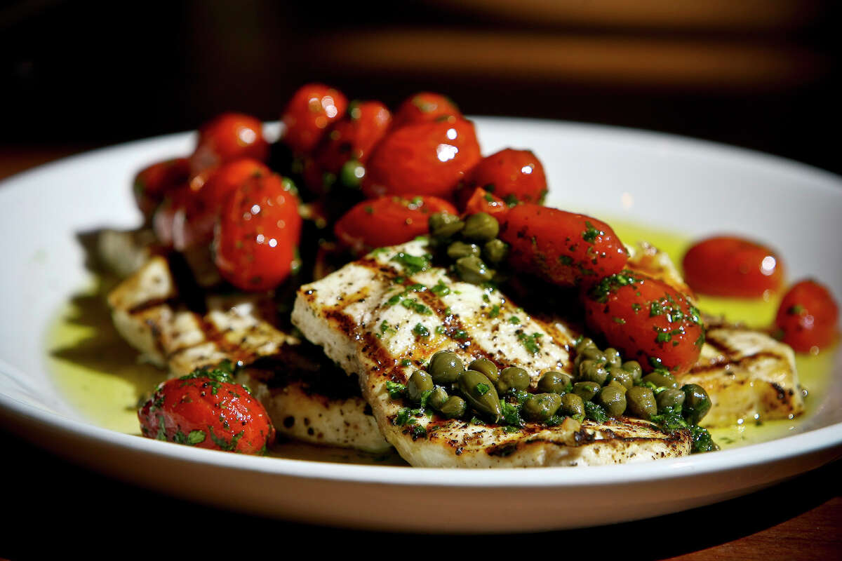 Grilled Swordfish with Capers and Tomato Confit is seen Tre Trattoria.
