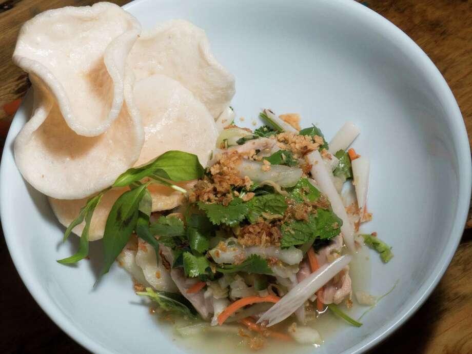 The lotus root chicken salad at Tuk Tuk Tap Room. Photo: Billy Calzada /San Antonio Express-News / San Antonio Express-News