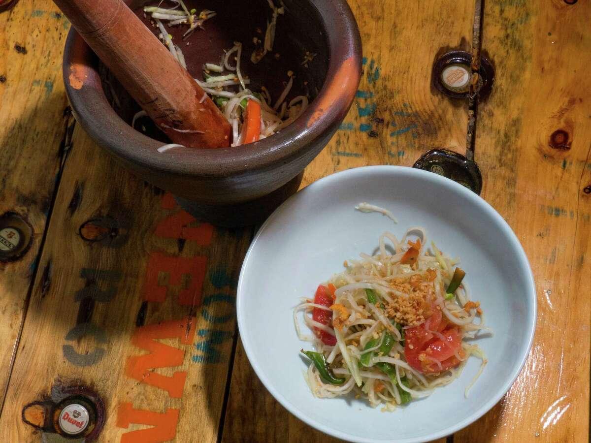 Green papaya salad (som tam) at Tuk Tuk Tap Room.