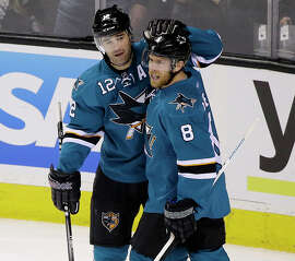 Sharks center Joe Pavelski (8) is greeted by Patrick Marleau after scoring a power play goal in the first period.