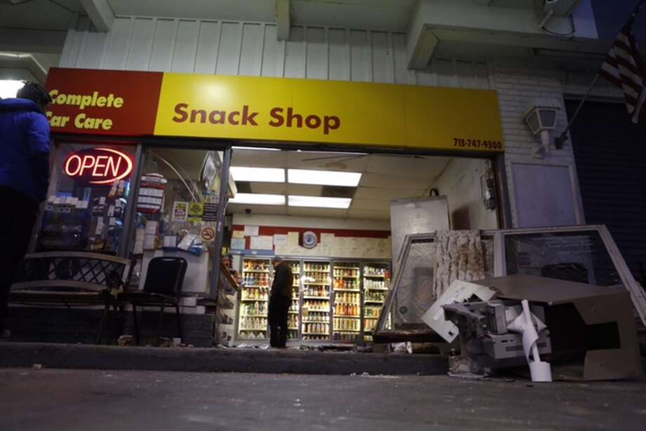 Would-be thieves apparently left empty-handed after they rammed a pickup through the glass doors of a gasoline station early Tuesday morning in south Houston. Photo: Cody Duty / Houston Chronicle