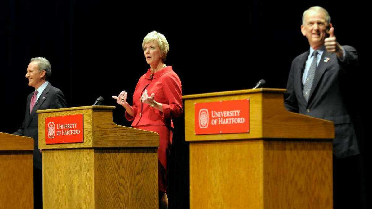From left, Republican hopefuls for U.S. Senate, money manager Peter Schiff, former World Wrestling Entertainment CEO Linda McMahon and Former Congressman Rob Simmons, debate at the Lincoln Theater on the University of Hartford campus in West Hartford, Conn., Tuesday, March 2, 2010. (AP Photo/John Woike, Pool)