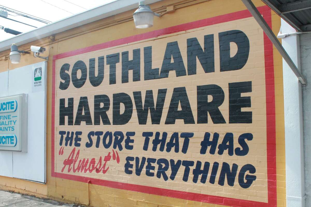 """Southland Hardware, the store that has """"almost"""" everything, has had the same painted signs for decades. Marty O'Brien just touches them up."""