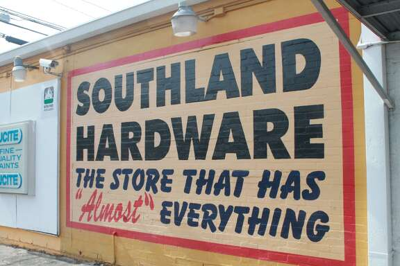 """The store that has """"almost"""" everything, has had the same painted signs for decades. Marty O'Brien just touches them up."""