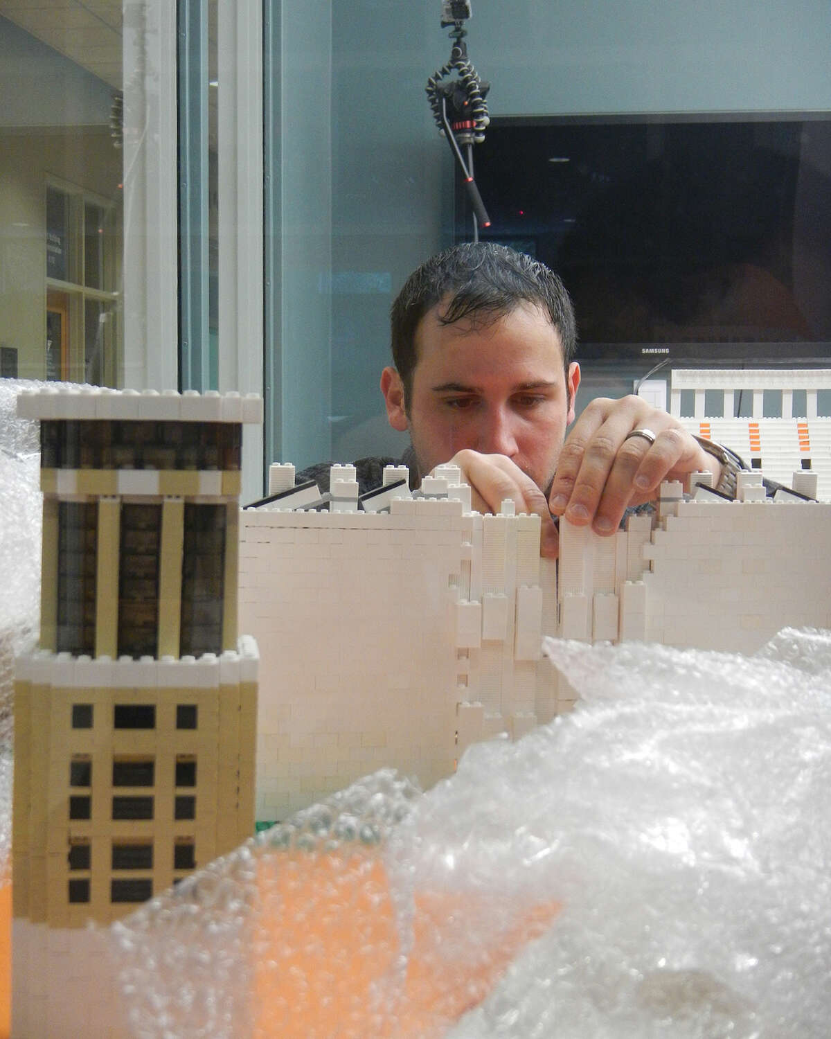 University of Texas alumni Drew Kinkel and Richard Meth rebuilt he Darrell K Royal Stadium in five hours Saturday with 60,000 LEGOs. Kinkel first built the model in his home in Chicago, but deconstructed it, shipped it and rebuilt it at the university's student center at the university's request.