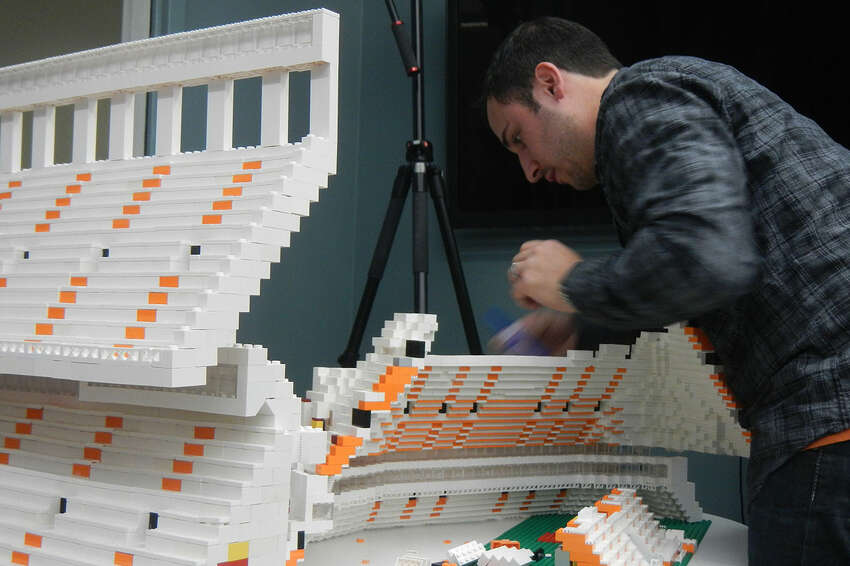 University of Texas alumni Drew Kinkel and Richard Meth rebuilt the Darrell K Royal Stadium in five hours Saturday with 60,000 LEGOs. Kinkel first built the model in his home in Chicago, but deconstructed it, shipped it and rebuilt it at the university's student center at the university's request