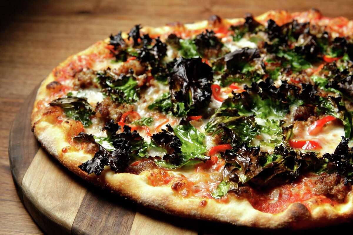 When you think of hotel restaurants, odds are images of sticky buffet lines and stale coffee pop in your mind. Not so at Main Kitchen, the posh eatery inside the JW Marriot Hotel in downtown Houston (806 Main.)Take this kale and sausage pizza for example. Described as
