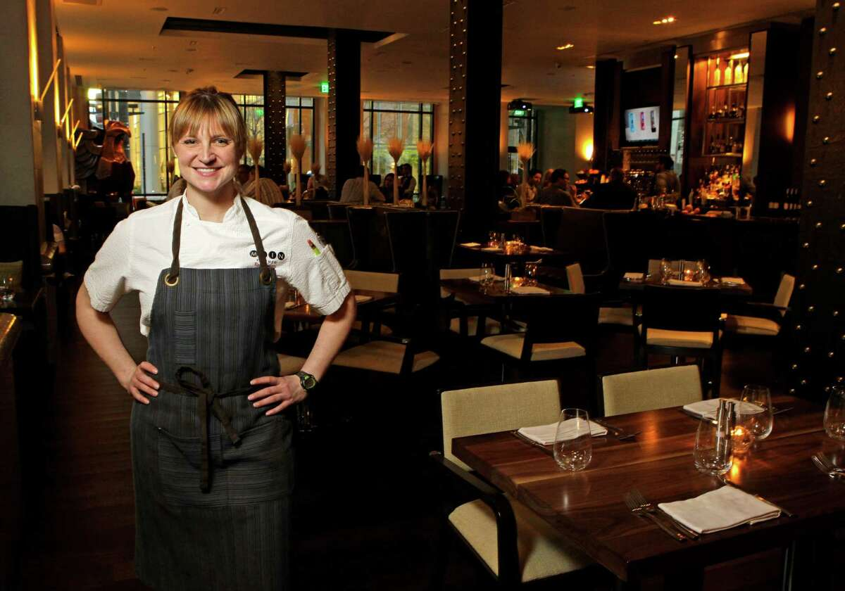 Chef Erin Smith poses in the Main Kitchen restaurant at the JW Marriott Houston Downtown.
