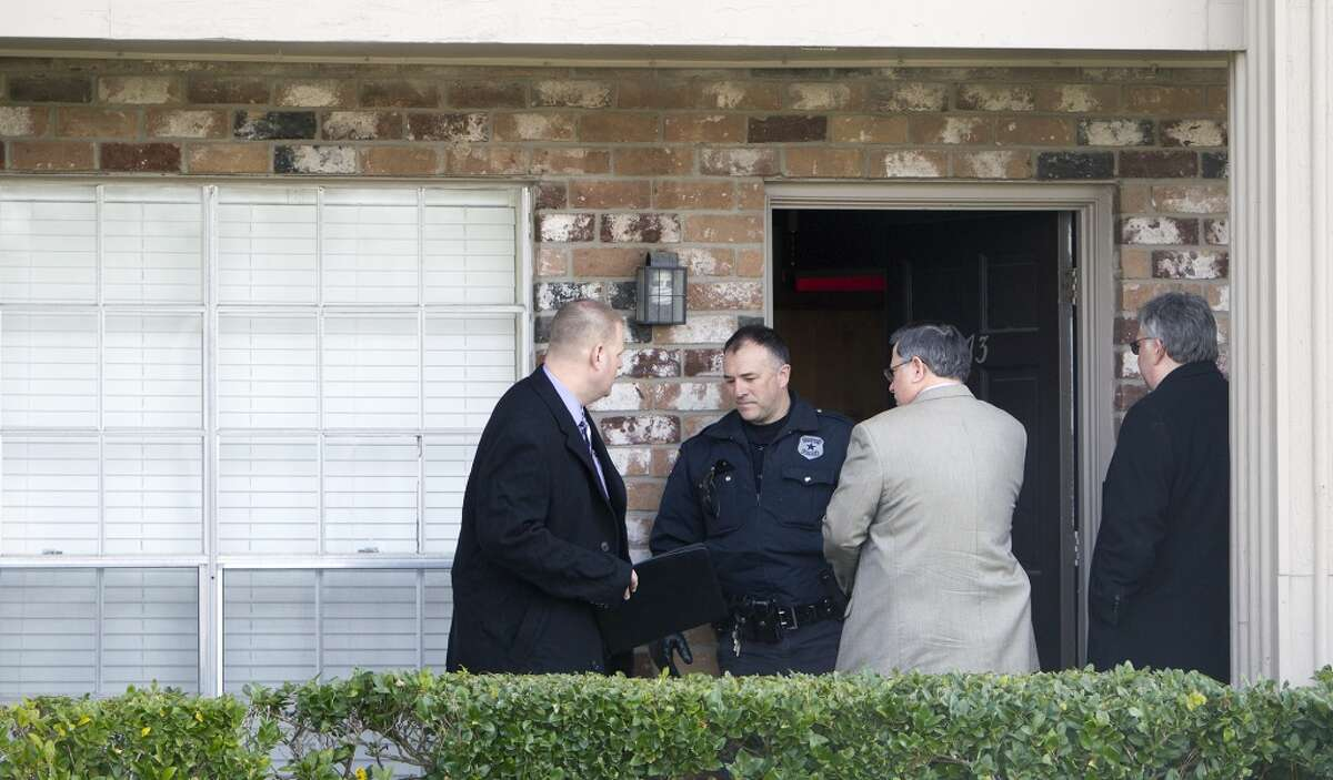Police investigate a scene after three people were found dead in an apartment on Strey near Barryknoll Monday, Feb. 2, 2015, in Houston. Police said preliminary reports indicate the three people died at the scene. Initial reports also indicate there was a great deal of blood at the apartment. (Cody Duty / Houston Chronicle)