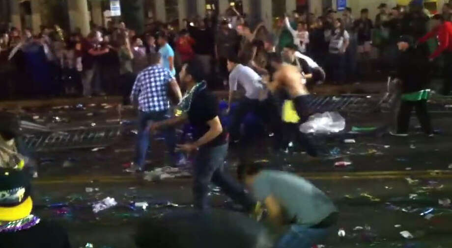 "A crowd at Mardi Gras Galveston 2013 hurls rocks, trash cans, beads and other debris at one another during a late night ""riot,"" as captured by YouTube user MercenaryxiM.PHOTOS: Scenes from Galveston Mardi Gras 2014 ...  Photo: YouTube"