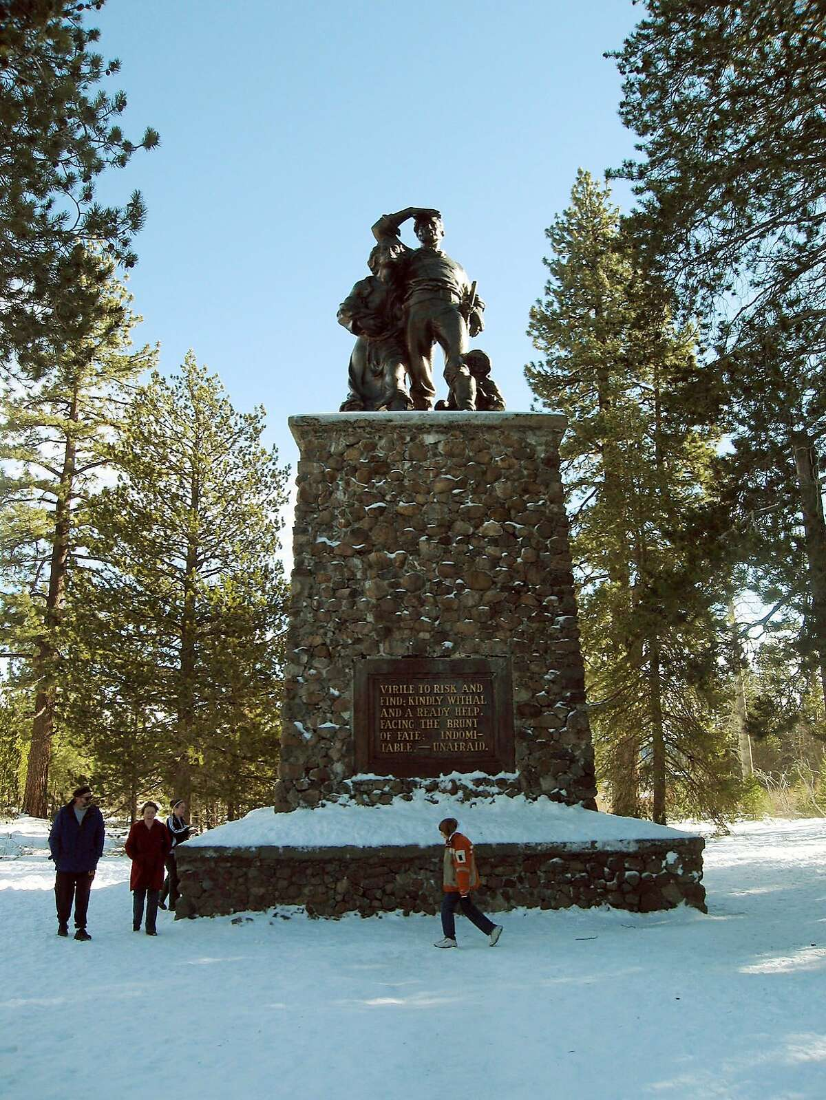 File - In this Jan. 2, 2007, file photo, visitors look at a monument depicting pioneers at Donner Memorial State Park, near Truckee, Calif. California parks officials say Gov. Jerry Brown's new budget proposal would make it possible to nearly double the operating hours planned at a new visitor's center and museum at Donner Memorial State Park north of Lake Tahoe. The center is scheduled to open in late spring 2015 along U.S. Interstate 80 near Truckee. (AP Photo/San Francisco Chronicle, John Flinn, File) ORTHERN CALIFORNIA OUT; MANDATORY CREDIT PHOTOG & CHRONICLE; MAGS OUT; NO SALES