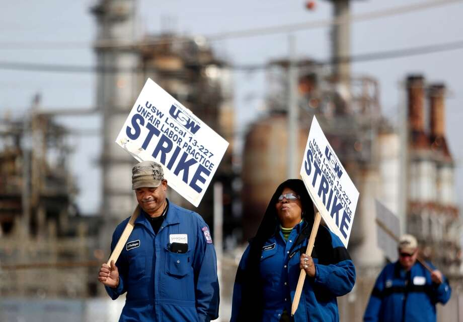 Dave Washington, left, Bobbie Thompson, and Kevin Hyde, United Steel Workers Local 13-227 members, employed by LyondellBasell Industries Houston, hold a strike claiming unfair labor practices at the oil refinery plant Monday, Feb. 2, 2015, in Pasadena, Texas. ( Gary Coronado / Houston Chronicle ) Photo: Gary Coronado, Houston Chronicle