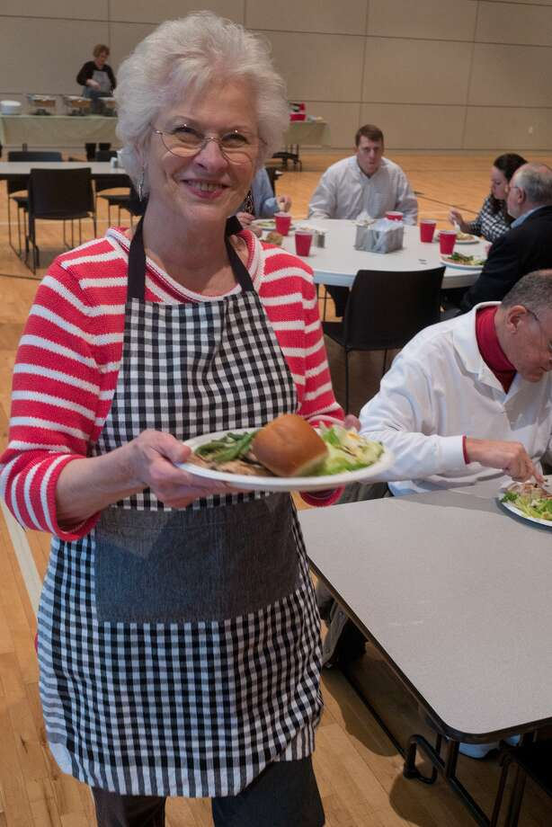 Kathy Rembert carries a plate for a customer at the 12@12 lunch at BridgePoint Bible Church in Memorial.  Kathy Rembert carries a plate for a customer at the 12@12 lunch at BridgePoint Bible Church in Memorial. Photo: R. Clayton McKee, Freelance / ©2015 R. Clayton McKee