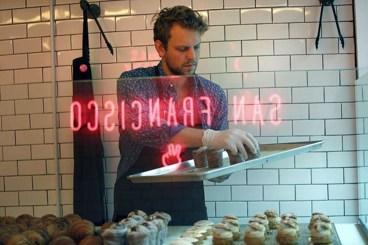 Director Chris Reinhardt of retail and wholesale operations fills the display with freshly made cruffins at Mr. Holmes Bakehouse in San Francisco, Calif., on Tuesday, January 27, 2015.