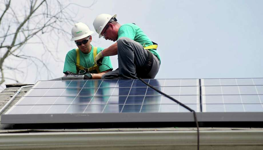 With a refurbished incentive program, Connecticut's Green Bank hopes to give homeowners a new option to finance the installation of solar panels -- via a surcharge on their annual property taxes. Photo: Lindsay Perry / Stamford Advocate