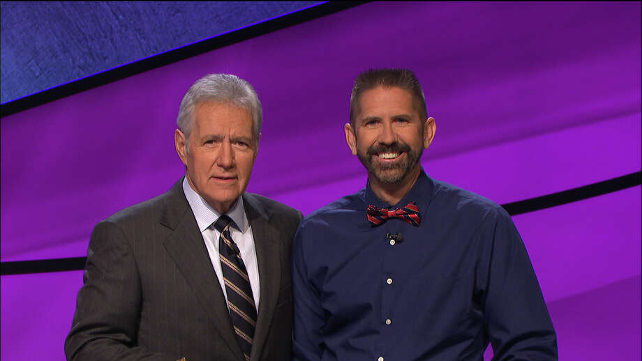 "Rex Marzke, right, is shown with ""Jeopardy!"" host Alex Trebek when Marzke appeared on the television quiz show. He won second place. Photo: Courtesy"