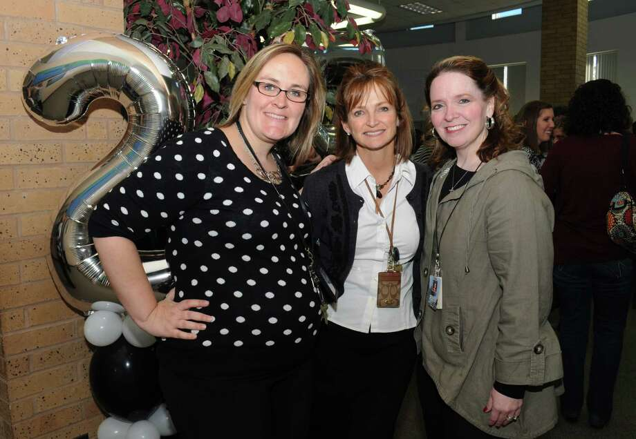 Austin Parkway Elementary assistant principal Courtney Dickey, left, current principal Donna Whisonant, and former principal Michele Riggs pose at the 25th anniversary. Photo: George Wong / Freelance