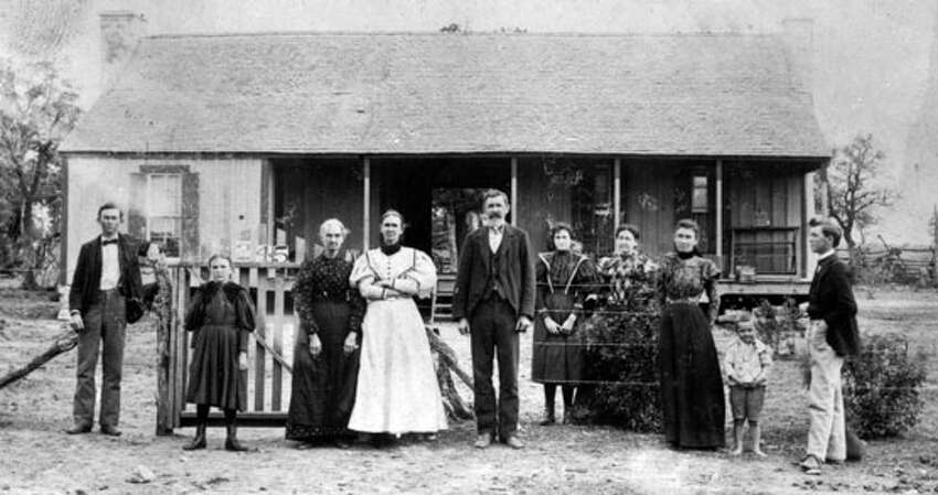 The Johnson family stands in front Lyndon B. Johnson's birthplace 1897.