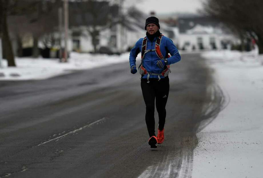 Jim Sweeney goes for a run even in the bad weather this morning Jan. 27, 2015 in Colonie, N.Y.       (Skip Dickstein/Times Union) Photo: SKIP DICKSTEIN / 00030352A