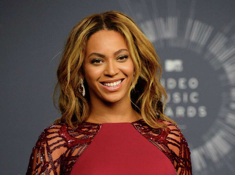 FILE - In this Aug. 24, 2014 file photo, Beyonce backstage at the MTV Video Music Awards in Inglewood, Calif. Beyonce is competing against, Sam Smith, Beck, Ed Sheeran,  and Pharrell for Album of the Year at this year's Grammy Awards on Sunday, Feb. 8. (Photo by Jordan Strauss/Invision/AP, File) Photo: Jordan Strauss, INVL / Invision
