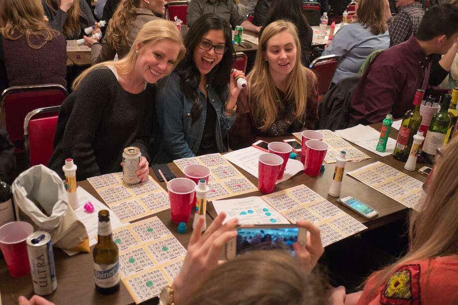 Hanna Skahn, left, Ana Sayson and Taylor Morrison take time out from bingo to mug for a camera at SPJST Lodge No. 88 in the Heights. The Thursday night games attract a diverse crowd that fills the building. Photo: R. Clayton McKee, Freelance / ©2015 R. Clayton McKee