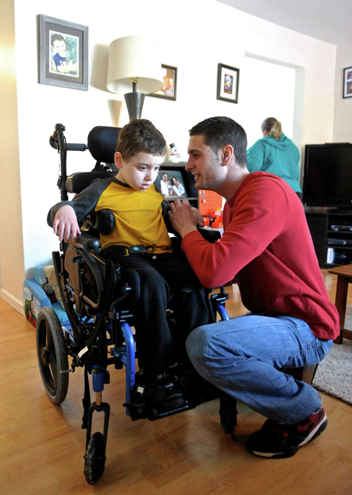 Jayce Correia brings his son Jared Carreras, 8, in from his ride home from school on Tuesday, February 3, 2015, in Brookfield, Conn. Correia made a video, of a rap song he composed, with Jared and uploaded it to YouTube. Jared was born with cerebral palsy, hydrocephalus, epilepsy, and several other debilitating medical conditions as a result of a stroke he suffered in utero. His parents feel that although Jared can't stand, walk, talk or see, he is a