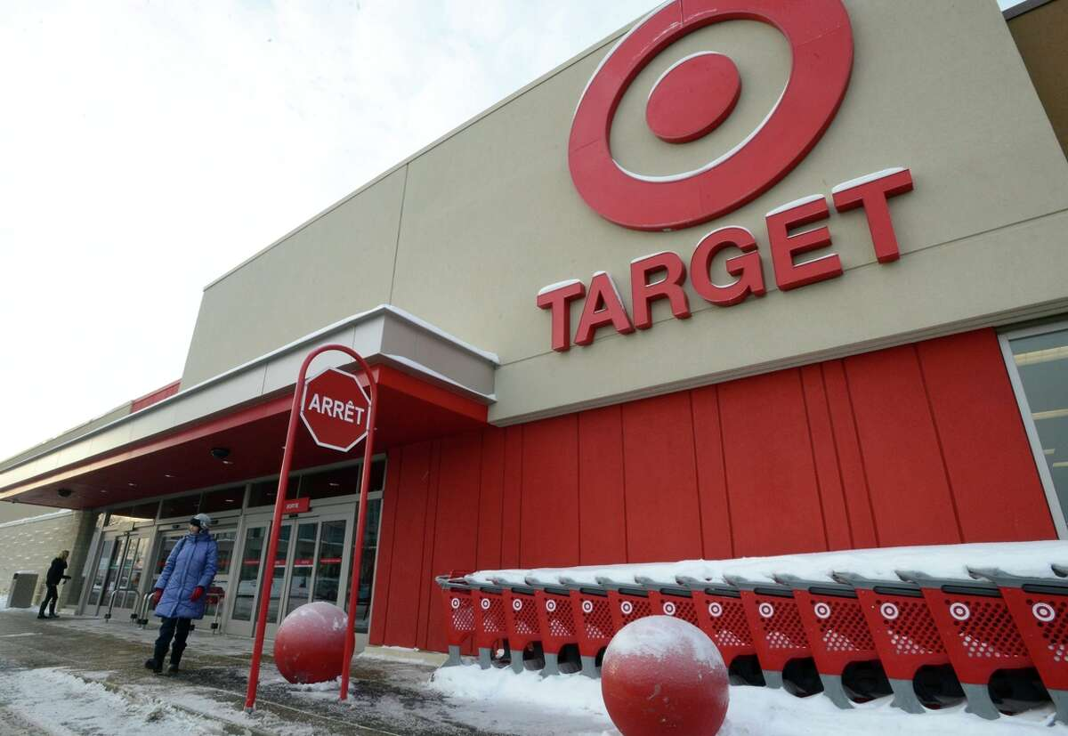 A woman stands outside Target in Saint-Eustache, Quebec. Target has given up on its Canadian stores because of problems throughout the country.