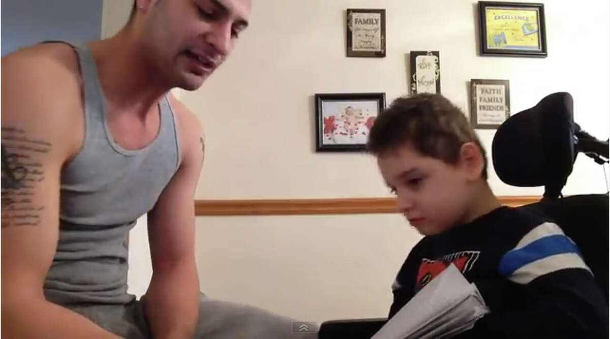 This is from a video clip of of Jayce Correia, left, and his son Jared, 8. Correia made a video of a rap song he composed with Jared and uploaded to YouTube.