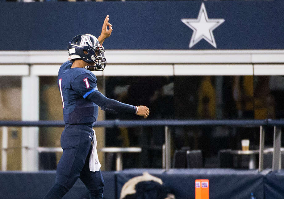 Allen quarterback Kyler Murray, who is expected to join Texas A&M on National Signing Day, leaves the field to an ovation during the fourth quarter of the Class 6A Division I state title game against Houston Cypress Ranch at AT&T Stadium on Dec. 20, 2014, in Arlington. Photo: Smiley N. Pool /Houston Chronicle / © 2014  Houston Chronicle