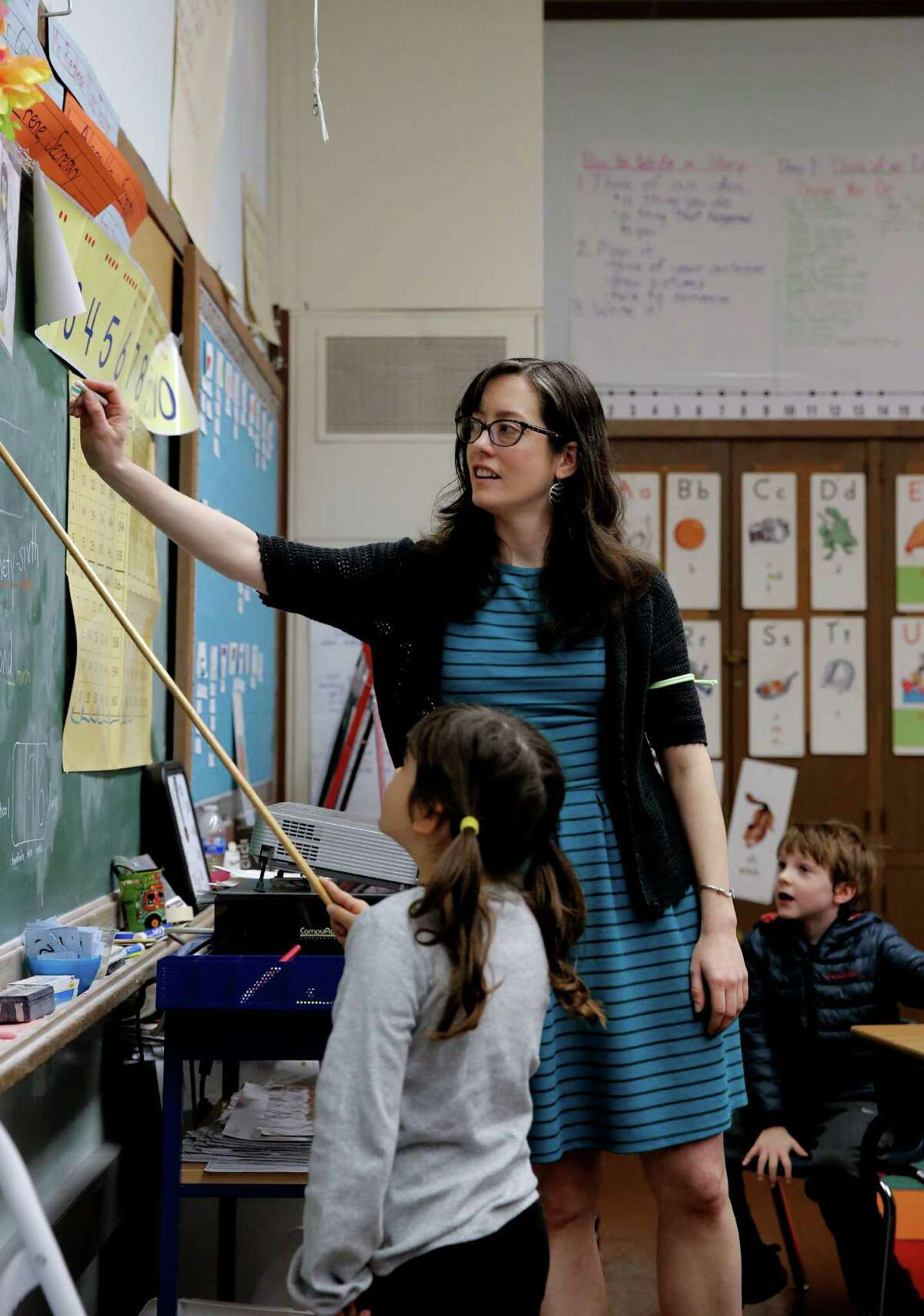 Valerie Lines teaches her first-grade class at Oakland's Montclair Elementary School. As part of a labor action, Lines is no longer staying late to visit with students and plan lessons.