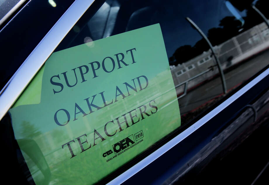 Signs in car windows and other tactics were employed by teachers during the long and sometimes contentious contract negotiations. Photo: Michael Macor / The Chronicle / ONLINE_YES